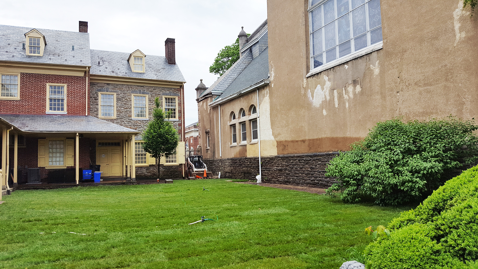 the new courtyard is primarily grass, rather than pavement