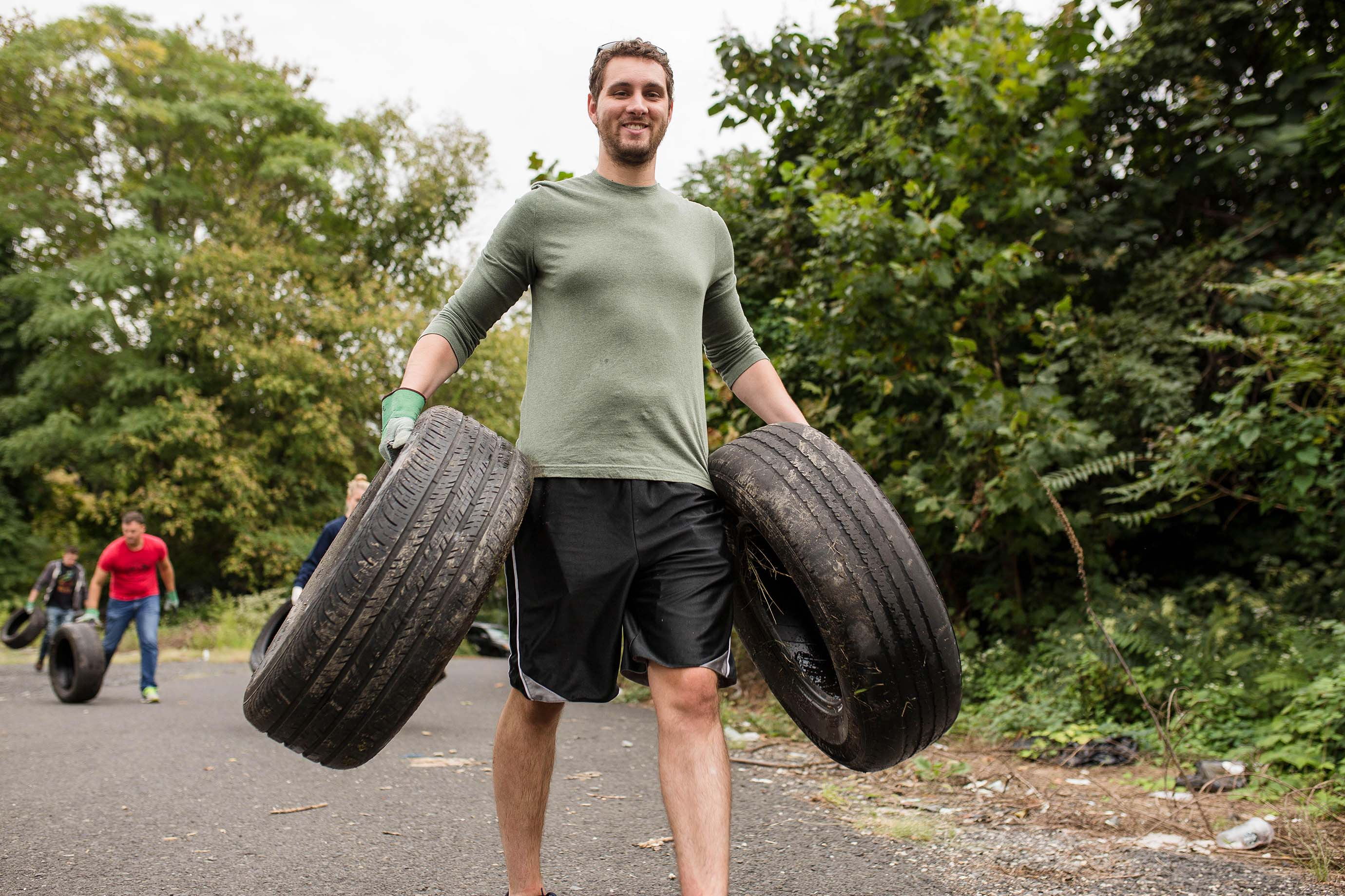 Tires are collected by volunteer at the Falls Road site in Fairmount Park.