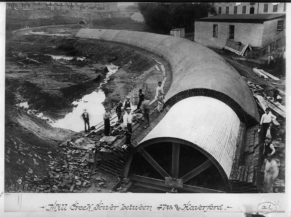 A historic photo shows Mill Creek Sewer under construction in 1887, looking upstream towards 47th Street and Fairmount Avenue.